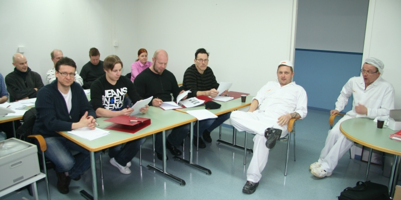 Giving training to bakers and production personnel