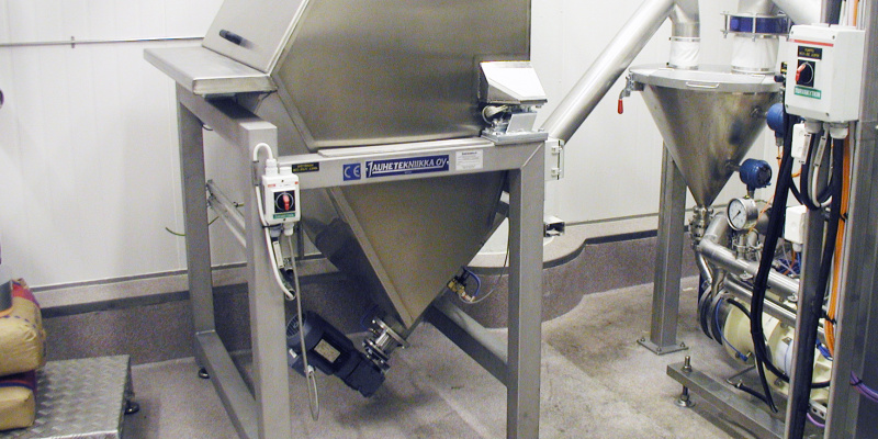 Automated dosing of cocoa powder to vacuum mixer. Valio Oyj