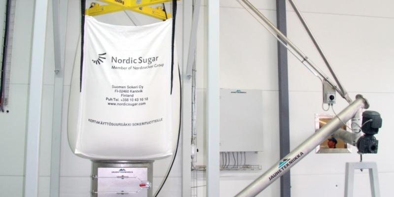 Dosing of sugar to mixer in dairy. Juustoportti Oy, Finland